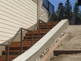 Exterior grab rail for stairs